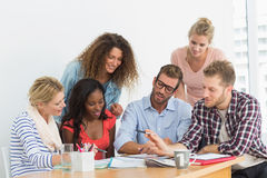 Team of young designers having a meeting Royalty Free Stock Image