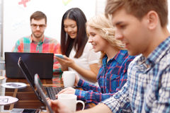 Team of young developers sitting at the table Royalty Free Stock Photography
