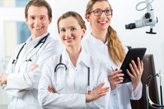 Team of young doctors in clinic with tablet computer Royalty Free Stock Photo