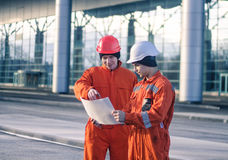 Team of  young engineers discussing a construction project Stock Images