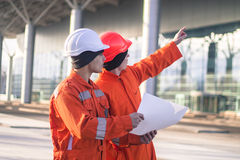 Team of  young engineers discussing a construction project Stock Image