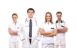 Four young medical workers standing in white clothes Royalty Free Stock Image