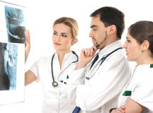 A team of young medical workers in white clothes Stock Photography