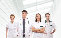 A team of young medical workers in white clothes Royalty Free Stock Photos