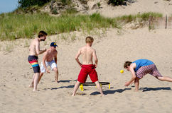 Team of young men play spike ball Stock Photo
