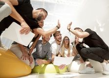 Team of young people giving a high five. Photo with copy space stock photos