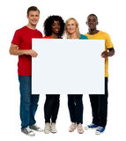Team of young people holding whiteboard Stock Photography