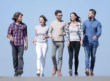 Team of young people walking along the road.outdoors royalty free stock images