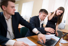 Team of young people works with documents Royalty Free Stock Photo