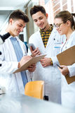 Team of young professional scientists working in laboratory. Stock Photography