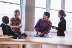 Team young professionals having casual discussion Stock Images