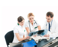 A team of young and smart doctors working together Royalty Free Stock Photography