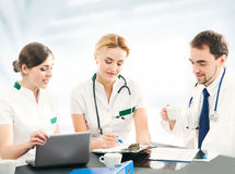 A team of young and smart doctors working together Stock Photos