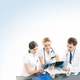 A team of young and smart doctors working together Stock Photography