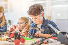 Team of young technicians in workshop Royalty Free Stock Photo