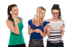 Team of young women working and communicating together Stock Images