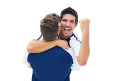 Teammates celebrating a win together Royalty Free Stock Images