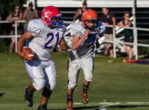 Teammates. Football players in action at the Lion's All Star Game in Redding, California Stock Photography
