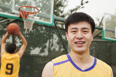 Teammates playing basketball Stock Photos