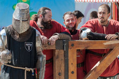 Teammates support knight. Ukrainian-Polish tournament of historical medieval battle. Maxim Gorky Central Park for Culture and Recreation. Ukraine. Kharkiv Stock Photography