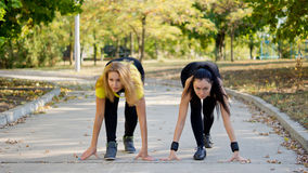 Teammates training for a running competition Royalty Free Stock Image