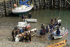 Teams and boats at Clovelly harbour, Devon Stock Image