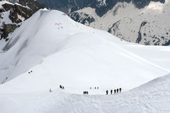 Teams of climbers in mountains. Near from Mont Blanc Stock Photos