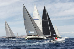 Teams competing on Maxi Yacht Rolex Cup sail boat race in Sardinia Royalty Free Stock Images