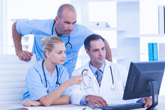 Teams of doctors working on laptop computer Stock Photos