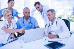 Teams of doctors working on laptop computer Royalty Free Stock Photo