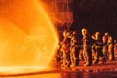 Teams of Firefighters working on  a fire Royalty Free Stock Images