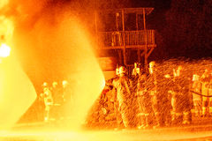 Teams of Firefighters working a fire Royalty Free Stock Images