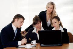 Teams of four people working Royalty Free Stock Image