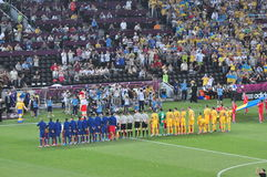 Teams of France and the Ukraine listening anthems Stock Image