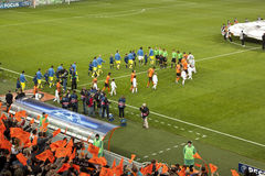 Teams go out on the field. DONETSK, UKRAINE - SEPTEMBER 28, 2011: The match of the Champions League FC Shakhtar Donetsk vs. FC Apoel Cyprus in Donetsk Donbass Royalty Free Stock Image
