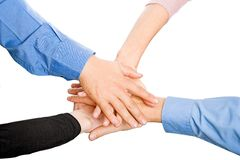 Teams Hands. Team with arms together in cooperation to look for success - isolated over a white background royalty free stock images