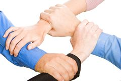 Teams Hands. Team with arms together in cooperation to look for success - isolated over a white background stock image