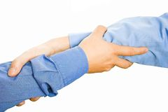 Teams Hands. Team with arms together in cooperation to look for success - isolated over a white background Royalty Free Stock Photography