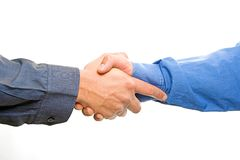 Teams Hands. Team with arms together in cooperation to look for success - isolated over a white background royalty free stock image