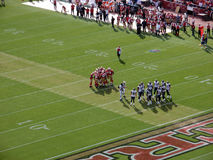 Teams hudle on field to talk about plays stock images