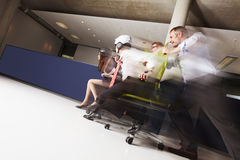 Teams In Office Chair Race. Stock Photo