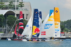 Teams preparing for race start at Extreme Sailing Series Singapore 2013. Teams preparing for race start at the Extreme Sailing Series race at Marina Bay stock photography