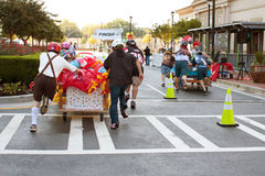 Teams Race To Finish Line Of Mattress Race Royalty Free Stock Photo