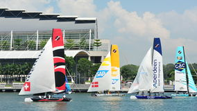 Teams racing at Extreme Sailing Series Singapore 2013 stock images