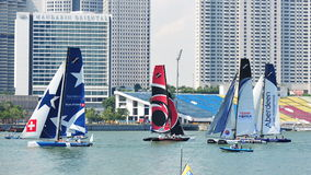 Teams racing at the Extreme Sailing Series Singapore 2013 Royalty Free Stock Photography