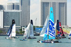 Teams racing at Extreme Sailing Series Singapore 2013 Stock Photo