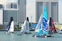 Teams racing at Extreme Sailing Series Singapore 2013 Stock Photo