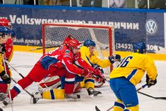Teams of Russia and Sweden play in hockey. Tyumen, Russia - April 19, 2008: International hockey tournament among youth teams till 20 years Tournament of four royalty free stock images
