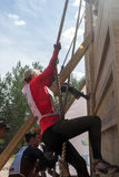 Teams storm wall in extreme race. Tyumen Stock Images