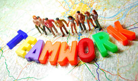 Teamwork. Group of miniature people and colorful teamwork message Stock Images